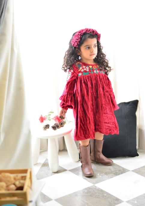 Ivanka sporting her red velvet Bella dress by Masala Baby